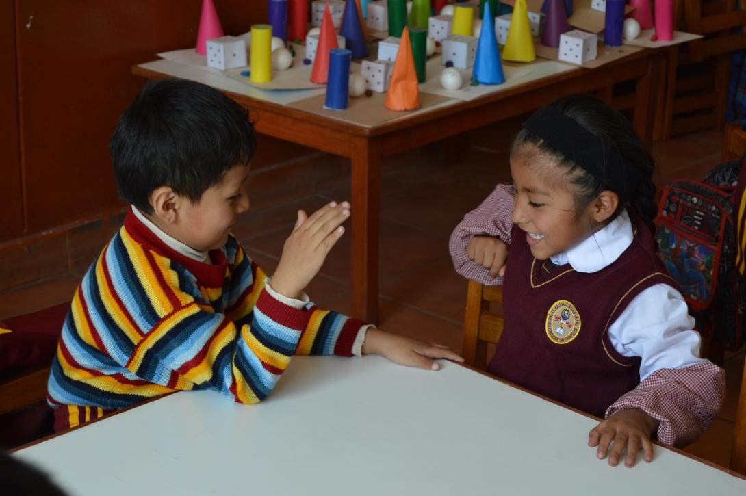 Young students play a game during their early childhood development class in Peru.